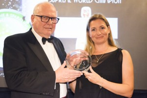 Charles King collects the 2015 Supreme World Champion trophy for Louis Roederer 2004 Cristal Rosé from Essi Avellan MW at the CSWWC 2015 Awards Dinner